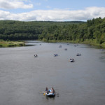 wide view of Delaware River with rafters enjoying the day Indian Head Canoeing Rafting Kayaking Tubing Delaware River