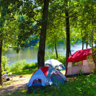 camping tents set up along river with rafters in distance Indian Head Canoeing Rafting Kayaking Tubing Delaware River
