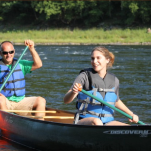 two people enjoying a sunny day on river in canoe Indian Head Canoeing Rafting Kayaking Tubing Delaware River