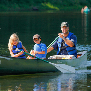dad daughter and son sharing canoe on river Indian Head Canoeing Rafting Kayaking Tubing Delaware River