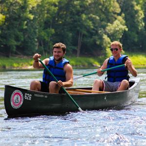 two guys in green canoe Indian Head Canoeing Rafting Kayaking Tubing Delaware River