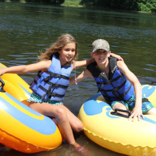 young kids getting ready for their tube ride on the river Indian Head Canoeing Rafting Kayaking Tubing Delaware River