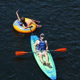 dad in kayak with daughter following in tube Indian Head Canoeing Rafting Kayaking Tubing Delaware River