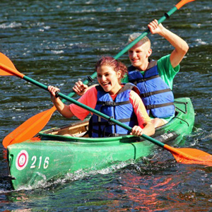 man and woman in friendly race with other kayakers Indian Head Canoeing Rafting Kayaking Tubing Delaware River