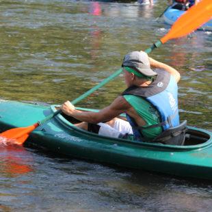 man in kayak showing his strength Indian Head Canoeing Rafting Kayaking Tubing Delaware River