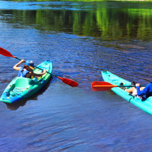 two young men in their own kayaks in Dingmans Ferry Indian Head Canoeing Rafting Kayaking Tubing Delaware River
