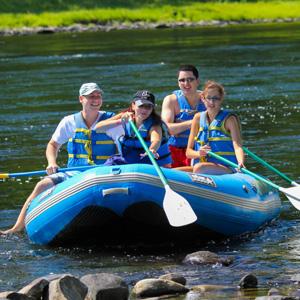 group of four in raft coming ashore in Matamoras Indian Head Canoeing Rafting Kayaking Tubing Delaware River