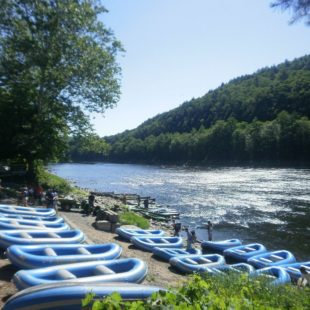 rafts staged on shore before guests arrive Indian Head Canoeing Rafting Kayaking Tubing Delaware River