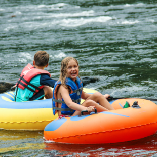young girl having fun in a tube on the river Indian Head Canoeing Rafting Kayaking Tubing Delaware River