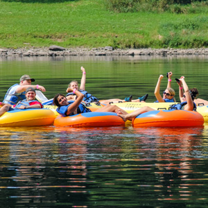 small group enjoying calm waters and scenic views on river Indian Head Canoeing Rafting Kayaking Tubing Delaware River